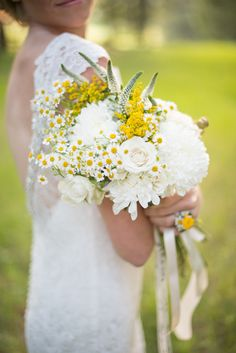 charming white rose and wildflower bouquet by Crocus Floral Design