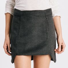 Karen Zambos Stella Skirt -Also in White Lush fabric Stella skirt. Front hand pockets with geometric hem cutout. Available in winter white and charcoal. 80% Poly, 20% viscose. Made in USA. Please comment desired size and a listing will be created for you. Available sizes: S Karen Zambos Skirts Mini