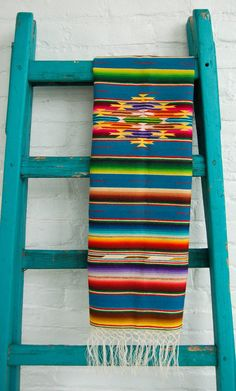 For a festive feast, set this Antique Mexican Saltillo Serape Runner  beneath your food spread