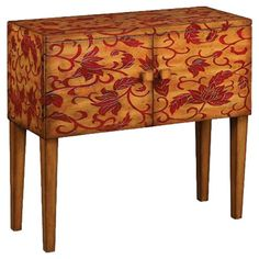 Sideboard with a hand-carved floral motif and removable shelf.       Product: SideboardConstruction Material: Wood...