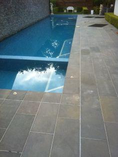 concrete pavers, natural stone outdoor surfaces, brick patio