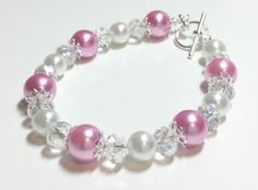 Pink and white glass pearls with clear crystal beads.