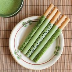 Homemade Green Tea Pocky Sticks. Ingredients: vanilla candy melts or white chocolate chips, matcha powder, vegetable oil, package of grissini for sticks, unsweetened desiccated coconut flakes, black sesame seeds, coffee sprinkles (I used Cacao Barry Coffee Vermicelli). | Thirsty for Tea