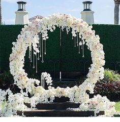 Roses, orchids, crystals, and an endless circle to represent the endless love in your marriage. #wedding #weddingstyle #weddingglam #ceremony #ceremonystyling #flowers #weddingflowers #decor #bride #bridestyle #seizetheday