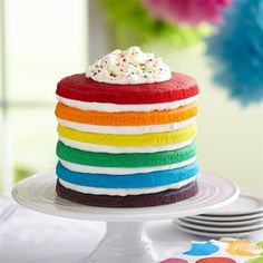 This Rainbow Cake recipe is an easy layered cake idea to celebrate St. Patrick's Day!