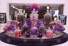Purple & Pink Candy Buffet @Carrie Mcknelly Rosnick : I like this because it shows how the chocolate can be added without taking away from color theme! :)..instead of pink and red, we can do white and cream colored