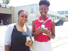 """Two excited ladies receive our Milwaukee car accident law firm's Mobile App card at Summerfest!  Get your Hupy and Abraham Mobile App card. Scan the QR code to download the app to your smartphone or text """"HUPY"""" to 77948."""