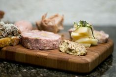 Assiete Grande Charcuterie: Duck and Pig Pate, Tartine of Pig's Foot and Mushroom, Cured Pork Jowl Rillette, Fromage Titette, Chicken Liver Mousse, Veal and Pistachio Mortadella, Red Wine-Cured Brizola, Traditional Pig's Head Scrapple, and Italian-Cut Kino Sausage