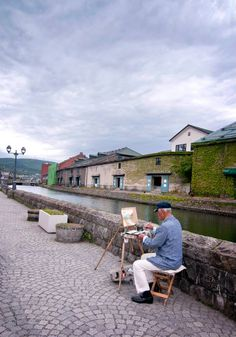 """ old painter at otaru canal, Otaru, Hokkaido, Japan. """