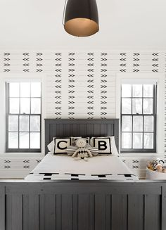 Graphic wallpaper is a playful yet timeless choice in a kid's bedroom.