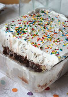 Brownie Bottom Ice Cream Cake - heavenly layers of brownie, chocolate frosting, ice cream and whipped topping. Super simple!