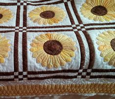 We love the quilting choices on this cheery sunflower quilt by Debbie. Perfect for summertime!