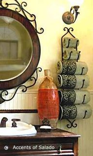 Tuscan Style Decorating... LOVE this!!! The towel rack the mirror, everything!!! Definitely want to incorporate into our bathrooms!