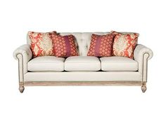Classic meets casual for an unbeatable combination in this gorgeous tufted sofa.  It features a carved weathered oak base and legs as well as brass nail head trim details.