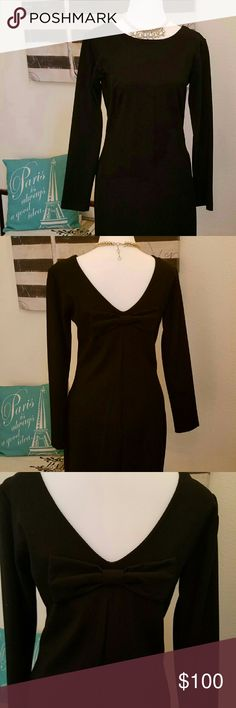 Amanda Uprichard LBD NWT long sleeves and a Bow! This will be your go to LBD for the holidays! Super comfy material hugs all the right places, stretch where you need it. Traditional crew neck, perfect for a statement necklace. V Back hits perfectly so you can wear regular undergarmets. Long sleeves to keep you warm. NWT from Neiman Marcus Amanda Uprichard Dresses Long Sleeve