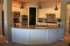 Another kitchen layout idea opening it up to FR with a curved counter and turning the corner DR entry into a pantry
