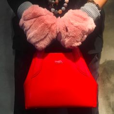 What We're Wearing. Lanvin purse and Joclyn Fur gloves, available at Milli. #milli #joclynfur #lanvin