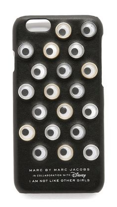 Playful googly eyes cover the front of this faux-leather Marc by Marc Jacobs x Disney® iPhone case.   Marc by Marc Jacobs Googly Eye iPhone 6 / 6s Case