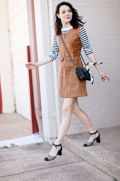 striped sweater with leather dress