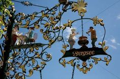 Wrought-iron advertising sign at Lake Titisee in the Black Forest, Baden-Wuerttemberg, Germany, Europe