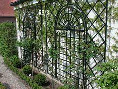 Metal Wall Trellis diamond lattice trellis panels with climbing plants. garden
