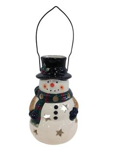 """Holiday Snowman Candle Lantern - Solid Stoneware Christmas Statuary - 10"""" tall. Put a candle or LED in it for a nighttime glow inside or out. This happy Genuine Stoneware Snowman can be used indoors or outdoors, on the ground or hung from the convenient handle. A great gift or addition to your own winter and Christmas decorations."""