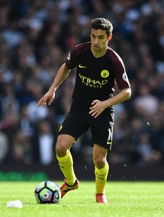 Jesus Navas of Manchester City takes the ball forward during the Premier League match between Tottenham Hotspur and Manchester City at White Hart Lane on October 2, 2016 in London, England.