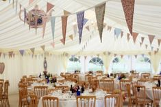 Marquee Interior - bunting it an easy way to decorate a marquee in your chosen wedding colours.