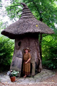 From Barb's blog: As you enter the gates, a warning is given to never enter the Forbidden Faerie Ring or you may not be seen again in this world! My friend, Renee', and I heeded the warning and wound our way along the path to a house made from a fallen Tulip Tree. Complete with a tiny hinged door and carved wooden chairs, this witch's hat-thatched hut launches your imagination.