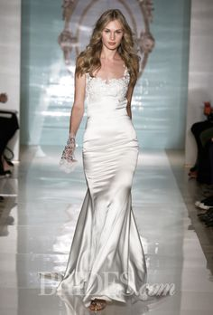 Brides.com: Reem Acra - Spring 2015. Sleeveless satin mermaid wedding dress with embroidered bodice details, an illusion neckline, and crepe back, Reem Acra
