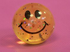 glittery smiley bouncy ball / toys