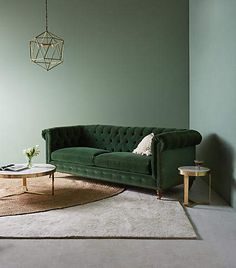 Living room decor perfection - soft green walls, rich green sofa & that amazing light fitting. Lyre Chesterfield Two-Cushion Sofa at Anthropologie. Living Room Sofa, Living Room Furniture, Home Furniture, Living Room Decor, Outdoor Furniture, Modern Furniture, Italian Furniture, Green Living Room Paint, Furniture Ideas