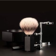 Muhle Shaving Set HEXAGON 3 Piece Silver Tip Badger Brush w/Safety Razor Graphite  Contemporary shaving implements, that are eye-catching, ergonomic and casually elegant, like a good pen, featuring a 3-part shaving set with a Silvertip Badger brush and safety razor in handles of symmetrical beauty, in an anodised aluminium with a matt metallic graphite finish.  Make your purchase today!! …