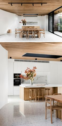 The light wood dining table and chairs compliment the ceiling and tie in with the modern and bright kitchen.