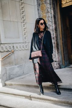 Blogger Tania Sarin in Montreal wearing Coach dress, Coach Dinky bag, dear frances boots, and clout sunglasses.
