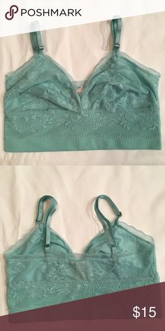 """Victoria's Secret Floral Lace Bralette Victoria's Secret unlined floral lace longline bralette. No wires and no padding. Adjustable bra straps. Bluish green color. ✅ New With Tags ❌ Price is firm!!! ❌ Smoke free & pet free —————————————————— For more items search """"xsmall funsizeshop"""" —————————————————— Ships: Mon, Wed, Fri, Sat Victoria's Secret Intimates & Sleepwear Bras"""