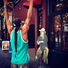 Martin Sensmeier being held up by a cardboard cowboy! Check out Martin's tribal tat!