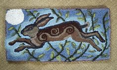 Michelham Hare rag rug Whimsey. The spiral follow the body and work well. Look at the lighter halo around the hare.