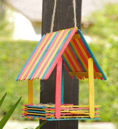 Popsicle stick art Embrace your inner Snow White and bring birds to your backyard with this adorable DIY Popsicle Bird House. Grab some colorful popsicles, hot glue, and start building! Let your little ones help you create this fun craft. Toddler Crafts, Kids Crafts, Diy And Crafts, Arts And Crafts, Decor Crafts, At Home Crafts For Kids, Magic Crafts, Family Crafts, Easy Crafts