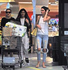 11.04.14. Kendall, Kylie, and Cara out shopping for Kendall's birthday party