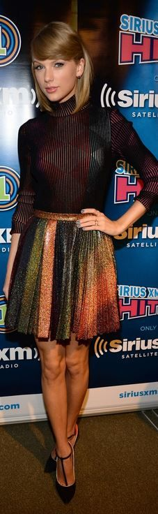 Taylor Swift�s black stripe top and rainbow pleated skirt that she wore in New York on October 29, 2014
