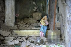 A Virgin Mary statue stands debris ruins in the Italian central town of Pescara…