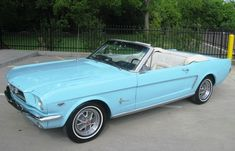 Left front view of a Tropical Turquoise 1965 Mustang convertible with steel styled wheels. My Dream Car, Dream Cars, Dream Life, Retro Cars, Vintage Cars, 1965 Mustang Convertible, Blue Mustang, Ford Mustang, Mustang Cabrio