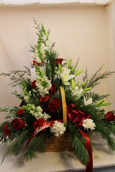 Beautiful family piece that accompanied a Winter/Christmas casket spray.With evergreens white lilies,white snaps and red roses