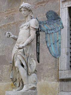 Si tratta della prima statua di S.Michele arcangelo eseguita nel 1544 da Raffaello da Monteluppo e collocata sulla sommita di Castel Sant'Angelo fino al 1752. Ora e nel cortile detto dell'Angelo. Angel And Devil, Patron Saints, St Michael, Catholic, San Michele, San Giorgio, Sculptures, Grave Markers, Carving