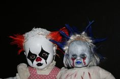 diy halloween props -- evil clown babies.  simple diy, buy dollar store dolls and craft paint and go to town with whatever you can dream up