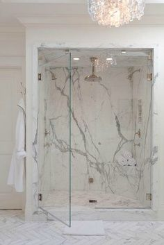 Bathroom - A walk in shower with beautiful marble walls.