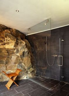Incredible #shower with a natural rock wall