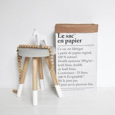 The paper bag is made of 180 gram double layered recycled paper. White on the outside, brown kraft paper on the inside and 32 x 60 cm with a capacity Nordic Living Room, Home And Living, The Paper Bag, Nordic Interior, Interior Design, Ppr, Living Room Inspiration, Rustic Interiors, Creative Home