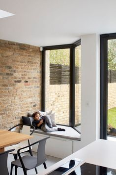 This window has a built-in window seat with an upholstered cushion and storage underneath.